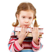 Offended preschool child holds textbooks — Stock Photo