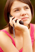 Beautiful young woman talking on cell phone — Stock Photo