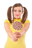 Girl with plaits holds lolipop — Stock Photo