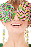Lovely girl closes eyes two lolipops — Stock Photo