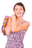 Beautiful girl with packages after shopping — Stock Photo