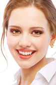 Portrait close up of smiling young woman — Stock Photo