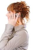 配置文件的年轻女子,由电话讲话 — 图库照片