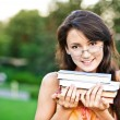 Girl-student holds textbooks — Stock Photo