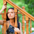 Foto Stock: Sad young womat handrail