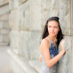 Beautiful girl about stone wall — Stock Photo