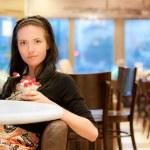 Charming young woman eats dessert — Stock Photo