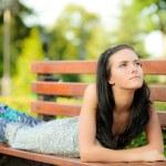 Beautiful girl lies in park — Stock Photo #3762863