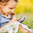 Little girl draws on PDA — Foto Stock