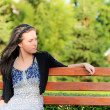 Beautiful brunette sits on bench — Stock Photo #3762870
