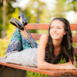 Beautiful brunette lies on bench — Stock Photo #3762871