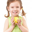Small girl with green apple — Stock Photo