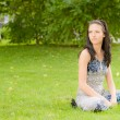 Young girl has rest on lawn — Stock Photo #3762885