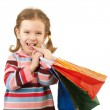Little girl with multi-colored packages — Stock Photo