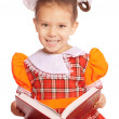 Girl with bows reads book — Stock Photo