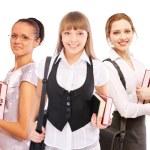 Three beautiful girls-students with textbooks — Stock Photo