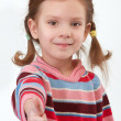 Little girl lifts forefingers upwards — Stock Photo #3762931