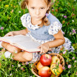 Little girl reads book — Stock Photo
