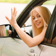 Driver-woman of car waves back — Stock Photo #3763043