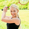 Sportswoman plays badminton — Stock Photo