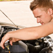 Car mechanician repairs engine — Stock Photo