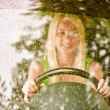 Stock Photo: Driver-woman of car at wheel