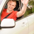Royalty-Free Stock Photo: Driver of car waves hand