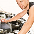 Car mechanician repairs engine — Foto de stock #3763124