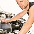 Photo: Car mechanician repairs engine
