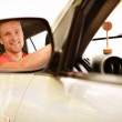 Driver is reflected in mirror — Stock Photo #3763152