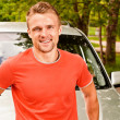 Driver of car smiles — Stock Photo