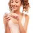Smiling girl dials number on phone — Stock Photo #3763366