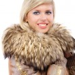 Portrait of smiling fair-haired woman in fur coat — Stock Photo #3763666