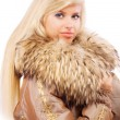 Portrait of smiling fair-haired woman in fur coat — Stock Photo