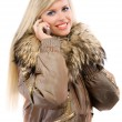 Charming blonde speaks by phone - Stockfoto