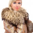 Portrait of smiling fair-haired woman in fur coat - Stock Photo