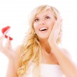 Girl with surprise looks at box with wedding ring — Stock Photo