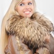Portrait of smiling fair-haired woman in fur coat — Stock Photo #3763886