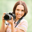 Beautiful girl with camera — Stock Photo #3763922