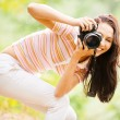 Beautiful girl with camera — Stock Photo #3763947