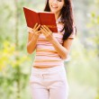 Lovely young woman reads book — Stock Photo #3763989