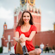 Woman sits on Red Square - Stock Photo