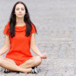 Woman in red dress meditates — Stock Photo #3764145