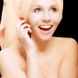 Woman after bath speaks on phone — Stock Photo #3764148