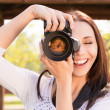 Beautiful girl with camera — Stock Photo