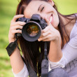 Beautiful girl with camera - Stock Photo