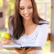 Stock Photo: Long-haired girl reads book