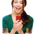 Stock Photo: Laughing young womreads sms