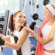 Stock Photo: Two beautiful sportwomen make exercise
