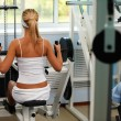 Girl on multi gym — Stock Photo